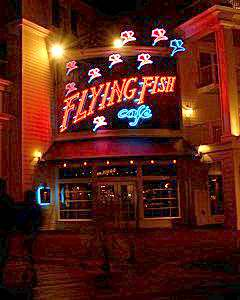 People strolling past the Flying Fish Café at night. Copyright © Scott Thomas Photography 2007
