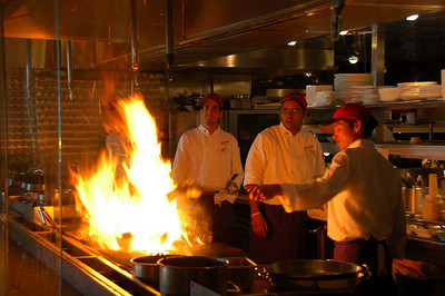 Chefs stoking the cooking fire at Flying Fish Café. Copyright © Scott Thomas Photography 2007