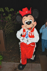 Cowboy Mickey Mouse leads the chain dance during his Backyard BBQ at the Fort Wilderness Resort, Walt Disney World, Orlando, Florida