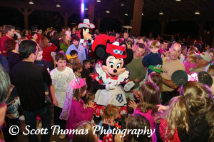 Minnie Mouse and Goofy dance in the midst of their young fans during Mickey's Backyard BBQ at the Fort Wilderness Resort, Walt Disney World, Orlando, Florida